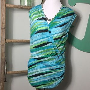 Beautiful wrap blouse with banded ruched bottom